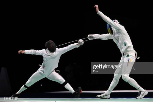 Zijie Wang of Team China, left, competes against Bogdan Nikishin of Team Ukraine in Men's Épée Team Quarterfinal on day seven of the Tokyo 2020...