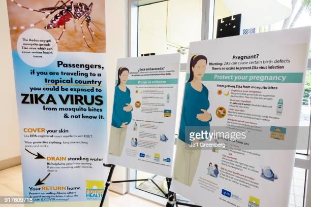 Zika Virus Town Hall Meeting posters at Waverly Condominiums