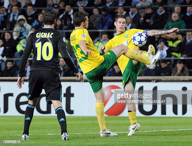 MSK Zilina's defender Lubomir Guldan passes a ball to his teammate defender Ondrej Sourek next to Marseille's forward AndrePierre Gignac during the...