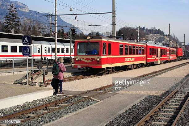 zillertalbahn train arriving at jenbach station - pejft stock pictures, royalty-free photos & images