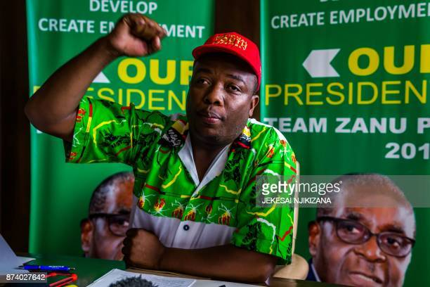 Zimbabwe African National Union Ð Patriotic Front Youth leader Kudzai Chipanga raises his fist as he chants the ruling party's slogan at a media...