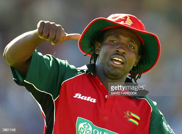 Zimbabwe allrounder Douglas Hondo is jubilant after the fall of Australia's Michael Bevan during the tri nations one day international Australia v...