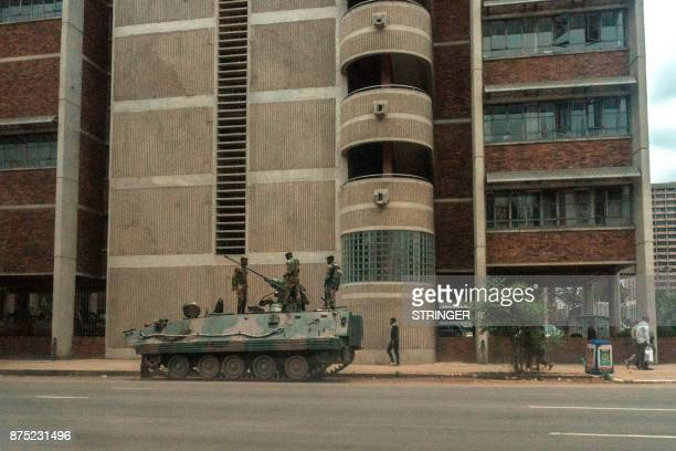 Zimbabwe Army personnel stand atop an armoured personnel carrier in Harare on November 17 2017 Zimbabwean President attended a university graduation...