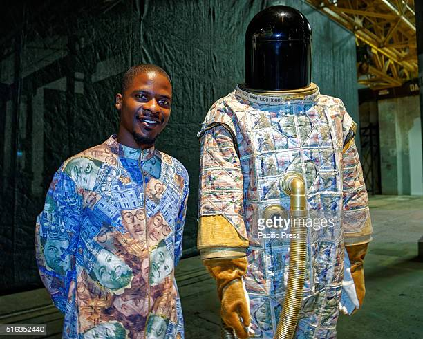 ISLAND SYDNEY NSW AUSTRALIA Zimbabwe artist Gerald Machona poses with his artwork 'Vabvakure ' at Carriageworks Embassy of Disappearance during the...