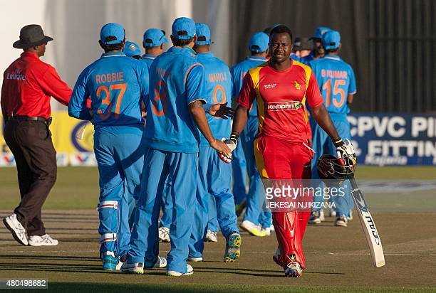 Zimbabwe batsman Brian Vitori leaves the pitch after losing the second game in a series of 2 ODI cricket matches between India and host Zimbabwe at...