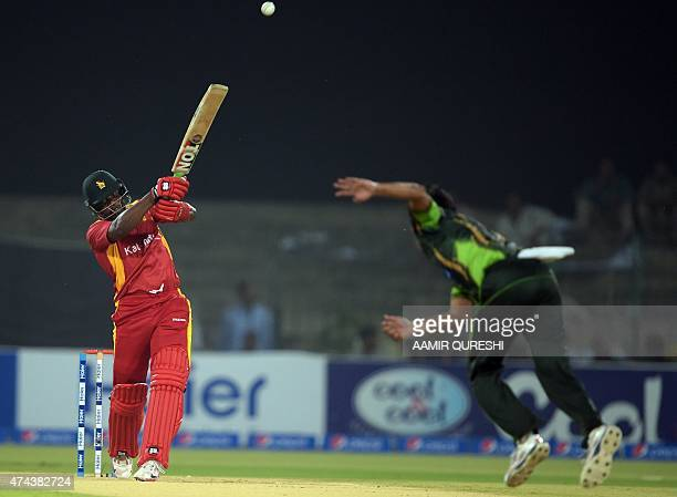 Zimbabwe batsman Hamilton Masakadza hits a shot during the first International T20 cricket match between Pakistan and Zimbabwe at the Gaddafi Cricket...