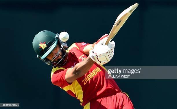 Zimbabwe batsman Sikandar Raza drives a ball from United Arab Emirates bowler Amjad Javed during the Pool B 2015 Cricket World Cup match between the...