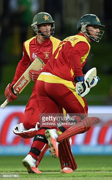Zimbabwe batsmen Sean Williams and Brendan Taylor take a run at the Bellerive Oval ground during the 2015 Cricket World Cup Pool B match between...