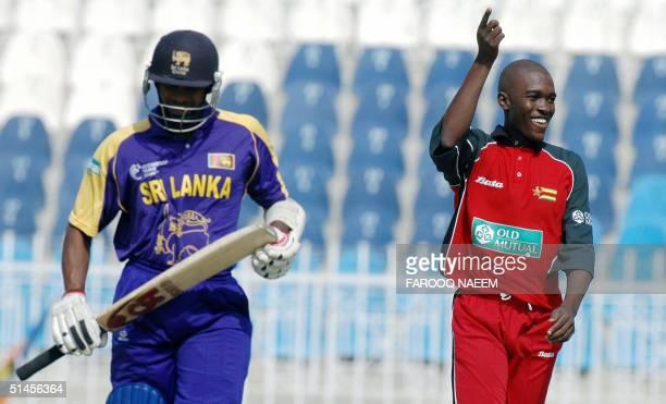 Zimbabwe bowler Elton Chigumbura gestures as he celebrates the dismissal of Sri Lankan batsman Saman Jayantha during the fourth triseries match...