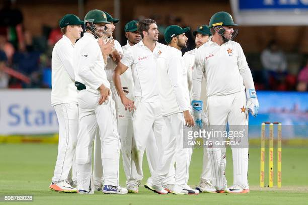 Zimbabwe bowler Graeme Cremer celebrates the dismissal of South African batsman Quinton de Kock during the first day of the daynight Test cricket...