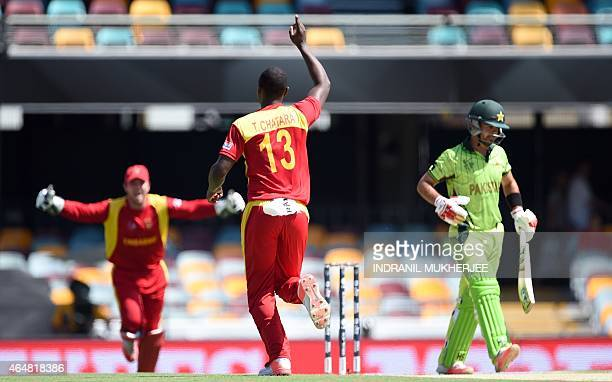 Zimbabwe bowler Tendai Chatara celebrates after taking the wicket of Pakistan cricketer Ahmed Shehzad during the 2015 Cricket World Cup Pool B match...
