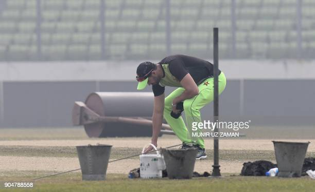 Zimbabwe captain Graeme Cremer inspects the pitch during a training session ahead of the One Day International match of the Trination Series in...