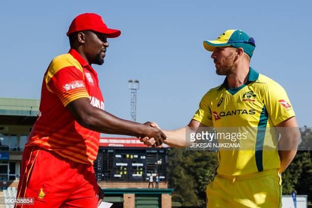 Zimbabwe captain Hamilton Masakadza shakes hands with Aaron Finch of Australia during the third match played between Australia and hosts Zimbabwe as...
