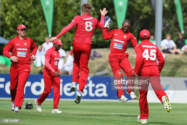 Zimbabwe celebrate during game one of the International One Day Series between New Zealand and Zimbabwe at University Oval on February 3 2012 in...