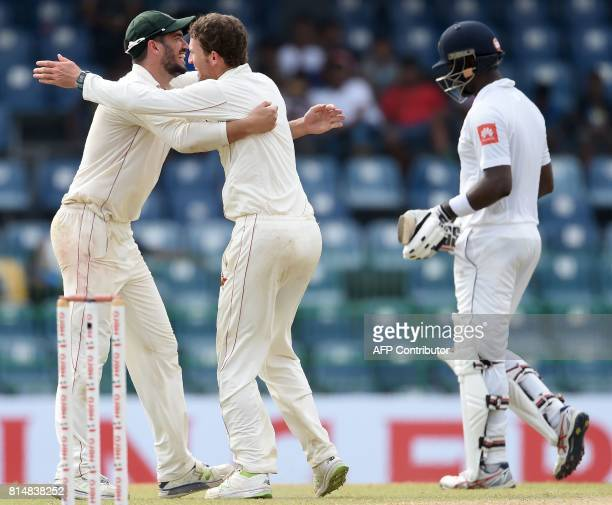 Zimbabwe cricket captain Graeme Cremer and Sean Williams celebrates after he dismissed Sri Lankan cricketer Angelo Mathews during the second day of...
