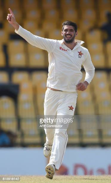 Zimbabwe cricket captain Graeme Cremer celebrates after dismissing Sri Lankan cricketer Upul Tharanga during the fourth day of a oneoff Test match...
