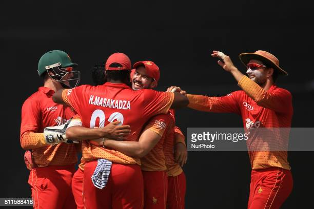 Zimbabwe cricket captain Graeme Cremer celebrates with his team mates during the 5th One Day International cricket matcth between Sri Lanka and...