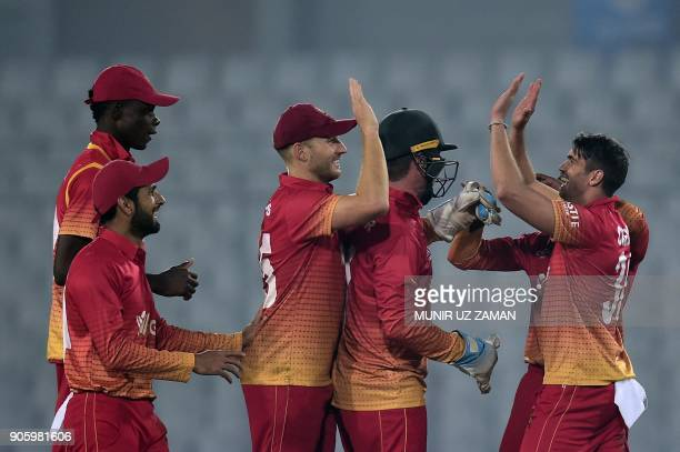Zimbabwe cricket captain Graeme Cremer celebrates with his teammates after the dismissal of the Sri Lanka cricketer Danushka Gunathilaka during the...