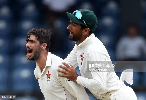 Zimbabwe cricket captain Graeme Cremer celebrates with teammate Sikandar Raza after dismissing Sri Lankan cricketer Angelo Mathews during the final...