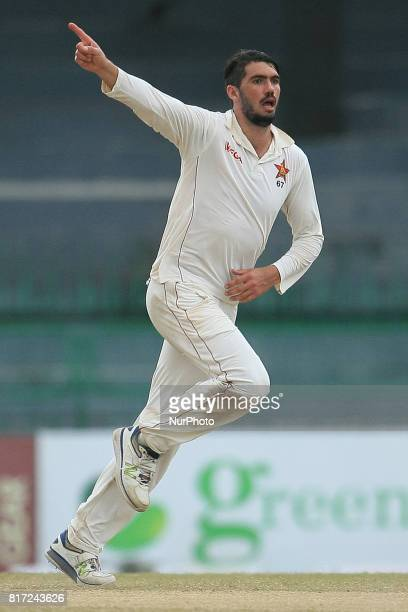Zimbabwe cricket captain Graeme Cremer in celebration mood after dismissing Sri Lankan cricket captain Dinesh Chandimal during the 4th day's play in...
