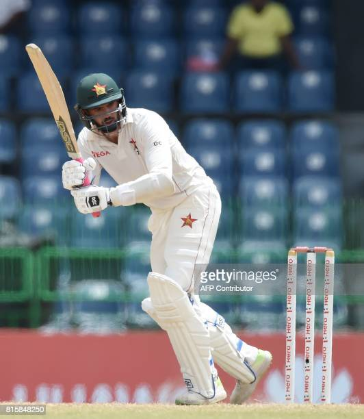 Zimbabwe cricket captain Graeme Cremer plays a shot during the fourth day of the only oneoff Test match between Sri Lanka and Zimbabwe at the R...