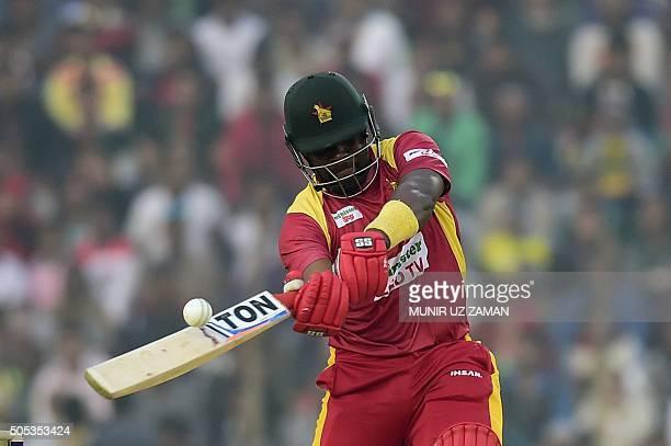 Zimbabwe cricket captain Hamilton Masakadza plays a shot during running between the wickets during the second T20 cricket match between Bangladesh...