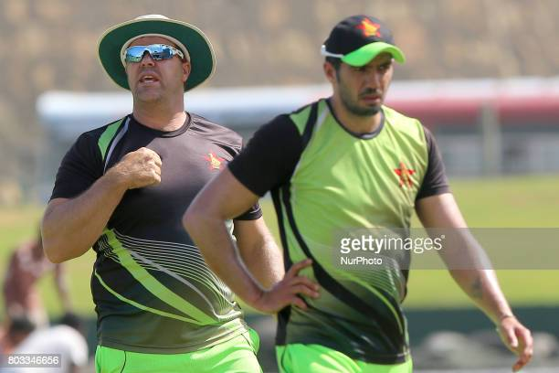 Zimbabwe cricket head coach Heath Streak and captain Graeme Creme are seen during a press conference ahead of their ODI match against Sri Lanka at...