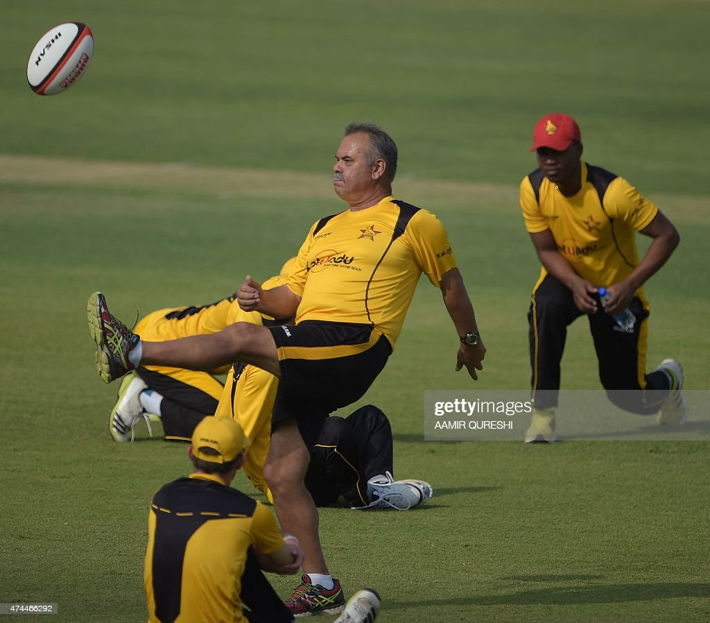Zimbabwe Cricket Team Coach Dave Whatmore Kicks A Rugby