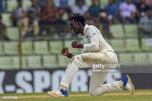 TOPSHOT Zimbabwe cricketer Brandon Mavuta celebrates after the dismissal of the after the dismissal of the Bangladesh cricketer Nazmul Islam during...