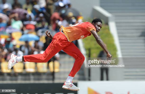 TOPSHOT Zimbabwe cricketer Chris Mpofu delivers a ball during the fourth oneday international cricket match between Sri Lanka and Zimbabwe at the...
