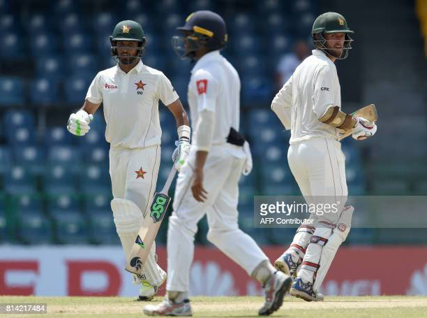 Zimbabwe cricketer Craig Ervine and Sikandar Raza run between the wickets during the first day of the only oneoff Test match between Sri Lanka and...