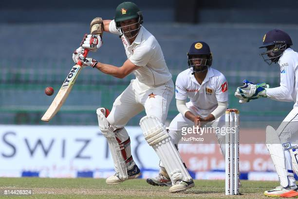 Zimbabwe cricketer Craig Ervine plays a shot as Sri Lanka's Kusal Mendis and Niroshan Dickwella look on during the first day of the only Test cricket...