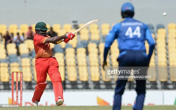Zimbabwe cricketer Hamilton Masakadza plays a shot during the third oneday international cricket match between Sri Lanka and Zimbabwe at the...