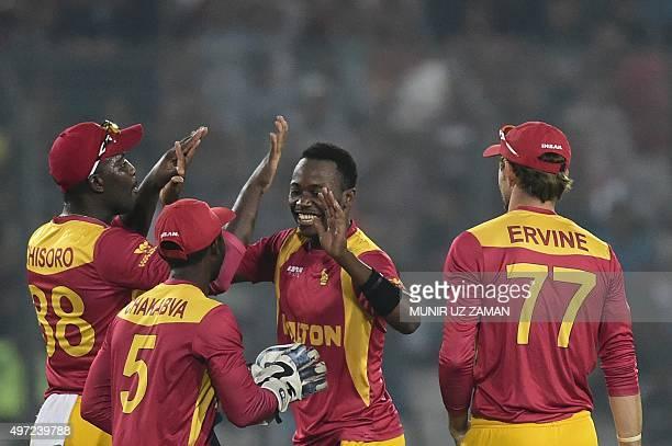 Zimbabwe cricketer Neville Madziva celebrates with his teammates after the dismissal of the Bangladesh cricket captain Mashrafe Bin Mortaza during...