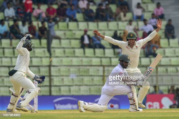 Zimbabwe cricketer Peter Moor and Regis Chakabva celebrate after the dismissal of the Bangladesh cricketer Imrul Kayes during the fourth day of the...