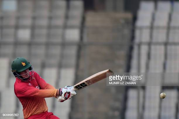 TOPSHOT Zimbabwe cricketer Peter Moor plays a shot during the second One Day International cricket match in the TriNations Series between Sri Lanka...