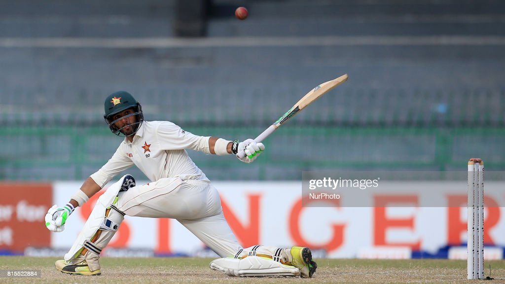 Zimbabwe cricketer Sikandar Raza plays a shot run during the third day's play of the only test cricket match between Sri Lanka and Zimbabwe at R Premadasa International cricket stadium in Colombo, Sri Lanka, Sunday, July 16, 2017.