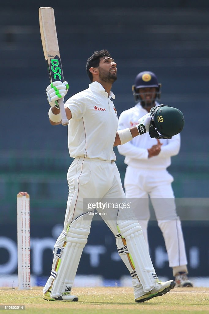 Zimbabwe cricketer Sikandar Raza raises his bat and look up at the sky after scoring 100 runs during the 4th day's play in the only Test match between Sri Lanka and Zimbabwe at R Premadasa International Cricket Stadium in the capital city of Colombo, Sri Lanka on Monday 17th July 2017