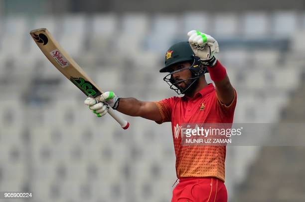 Zimbabwe cricketer Sikandar Raza reacts after scoring a halfcentury during the second One Day International cricket match in the TriNations Series...