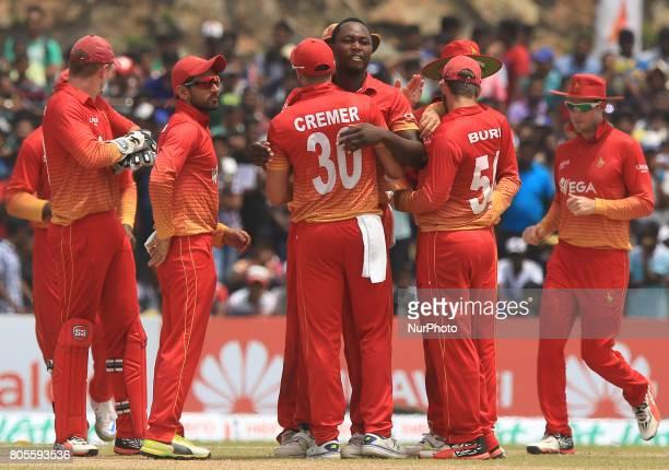 Zimbabwe cricketer Tendai Chatara celebrates with his fellow team mebers after taking the wicket of Sri Lanka's Danushka Gunathilaka during the 2nd...