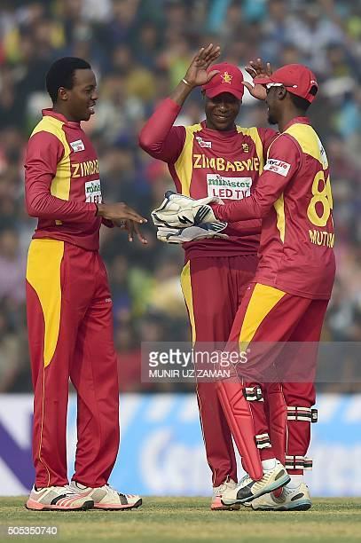 Zimbabwe cricketer Wellington Masakadza celebrates with teammates after the dismissal of Bangladesh cricketer Mohammad Mahmudullah during the second...