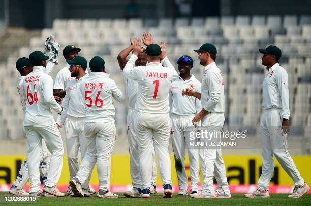 Zimbabwe cricketers celebrate after the dismissal of Bangladesh's cricketer Saif Hassan during the second day of a Test cricket match between...