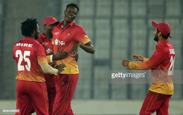 Zimbabwe cricketers celebrate after the dismissal of Sri Lankan Niroshan Dickwella during the fourth One Day International cricket match in the...