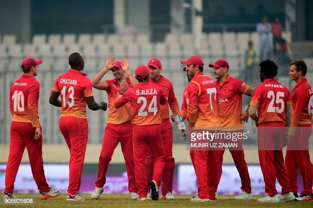 Zimbabwe cricketers celebrate after the dismissal of Sri Lanka's Kusal Mendis during the second One Day International cricket match in the TriNations...