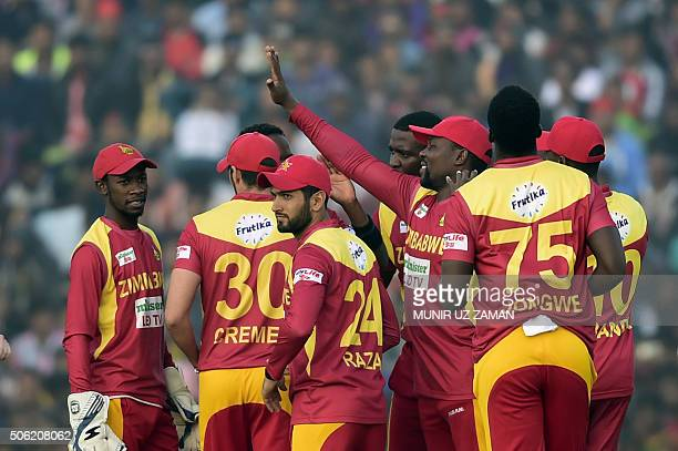Zimbabwe cricketers celebrate after the dismissal of the Bangladesh cricketer Soumya Sarkar during the fourth T20 cricket match between Bangladesh...