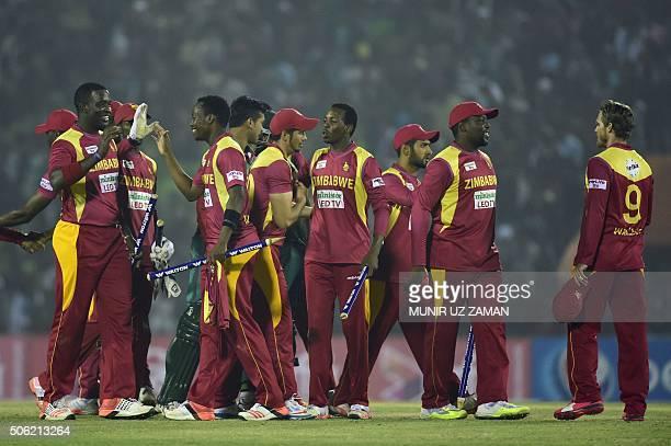 Zimbabwe cricketers celebrate after winning the fourth T20 cricket match between Bangladesh and Zimbabwe at the Sheikh Abu Naser Stadium in Khulna on...