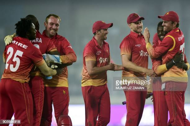 Zimbabwe cricketers celebrate after winning the second One Day International cricket match of the TriNations Series between Sri Lanka and Zimbabwe at...