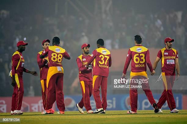 Zimbabwe cricketers celebrate after winning the third T20 cricket match between Bangladesh and Zimbabwe at the Sheikh Abu Naser Stadium in Khulna on...