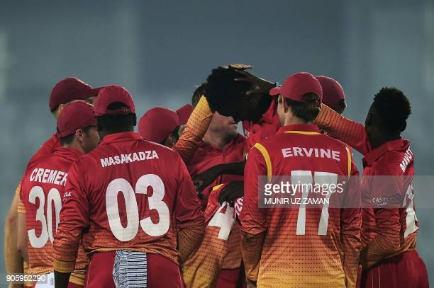 Zimbabwe cricketers congratulate teammate Blessing Muzarabani after the dismissal of the Sri Lanka cricket captain Angelo Mathews during the second...