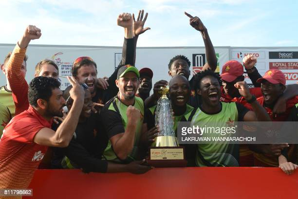 Zimbabwe cricketers pose for photographers after victory in the fifth oneday international cricket match between Sri Lanka and Zimbabwe at the...